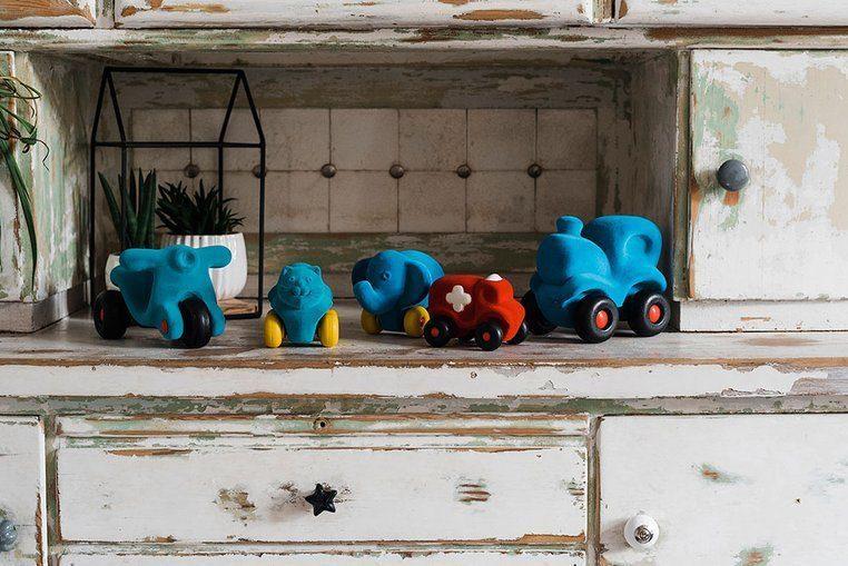Zabawka rozwojowa w kształcie zielonego dinozaura dla dzieci od Rubbabu